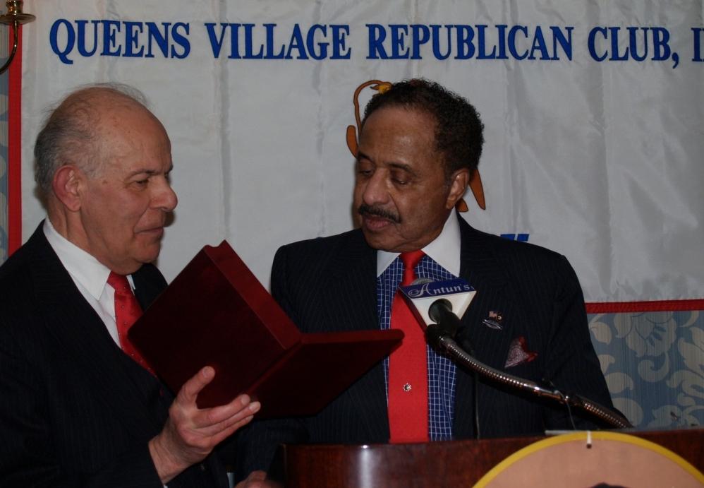 Rev. Philip Sica presents Veteran of the Year award to LTC Peterkin