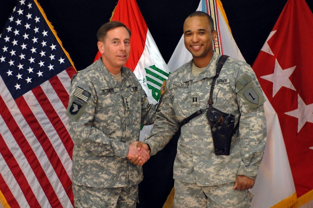 Captain James Van Thach is congratulated for this service by Gen. David Patraeus