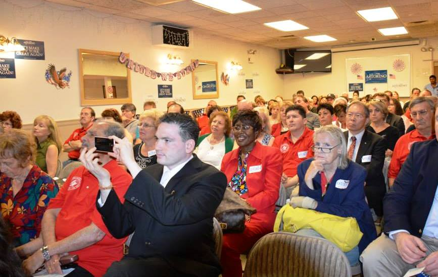 Enthusiastic supporters filled the meeting hall to capacity many wearing their Red QVGOP Shirts sporting the Club logo
