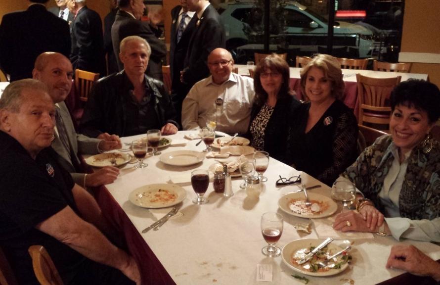 Diamond Sponsor Sam Borofsky, at the head of the table. Silver Sponsor William Mahlan,