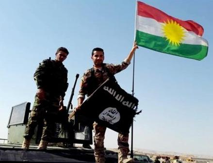 Peshmerga throw down ISIS Flag and raise Kurdistan Flag after defeating ISIS. Photo Credit: Kurdishstruggle